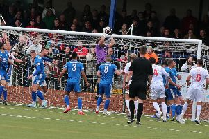 Buxton keeper Grant Shenton plucks a high ball out of the air.