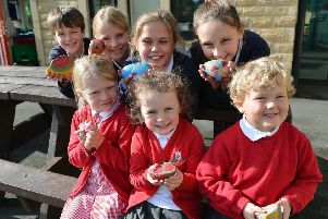 Hayfield primary school pupils paint rocks for World mental health day. Reception and year 6 pupils.