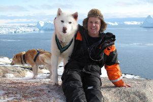 Doug Allen and husky in Greenland.