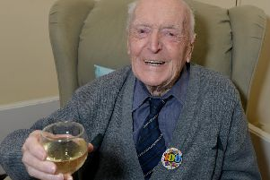 Avid Rams fan Derek Eley, pictured celebrating his 100th birthday. He will soon turn 102.