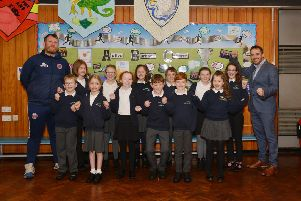 Burbage Primary School are fundraising for a new multi-use sports pitch, pictured is headteacher Anthony Teirney and sports coach Chris Hill with school house captains