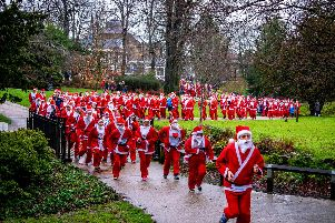 Crowds donned Santa suits at last years Jingle Bell Jog.