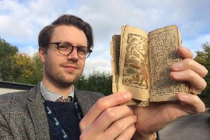 Jim Spencer with the ancient book found in Buxton. Photo: Hansons.