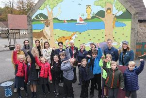 Whaley Bridge Primary School celebrate their new mural and climbing wall with artists Lyndsey Selley and Rob Wilson and guests from the PTA and Tesco.