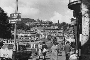 A view of the Quadrant shopping street in Buxton, Derbyshire, with the thermal baths on the left and the Palace Hotel in the background (centre), 1961. Photo by Fox Photos/Hulton Archive/Getty Images.