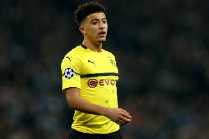 LONDON, ENGLAND - FEBRUARY 13: Jadon Sancho of Borussia Dortmund looks on during the UEFA Champions League Round of 16 First Leg match between Tottenham Hotspur and Borussia Dortmund at Wembley Stadium on February 13, 2019 in London, England. (Photo by Clive Rose/Getty Images)