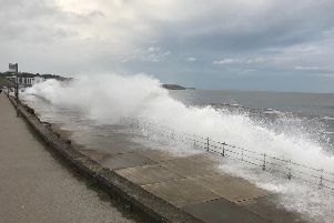 A section of Marine Drive has been closed due to waves overtopping sea defences.