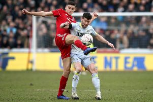 ACCRINGTON, ENGLAND - JANUARY 26:  Ross Sykes of Accrington Stanley battles for possession with David Nugent of Derby County during the FA Cup Fourth Round match between Accrington Stanley and Derby County at Wham Stadium on January 26, 2019 in Accrington, United Kingdom.  (Photo by Jan Kruger/Getty Images)