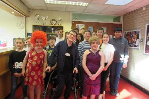 Jack Carroll with pupils at Brighouse High School