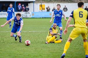 Pontefract Collieries' ex-Frickley player Jake Picton looks to get to the ball first against his former club. Picture: James Heaton