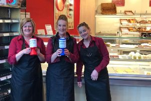 Oddie's counter assistants ( from left)  Dawn Grant, Christine Smith and Lisa Tomlinson) at the Padiham Road, Burnley shop with the collection tins.