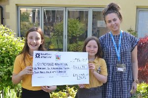 Litton Mill sisters Alice and Emily Lewis raised �2,790 for hospice charity Blythe House with a bake sale in memory of their mum, who died last month.