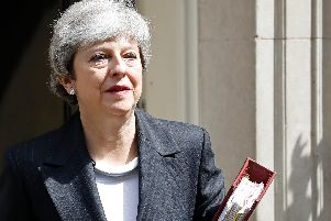 Theresa May will step down as leader of the Conservatives on June 7. Photo - Tolga Akmen/AFP/Getty Images
