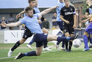 New Buxton signing Alex McQuade in action for Ossett United