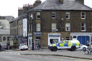 Police tape around buildings on Market Place. Picture taken by John Phillips.