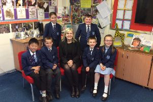 Headteacher Jayne Mercer with children from the school.