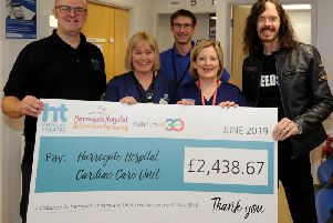 Cheque presentation to Harrogate Hospital Cardiac Care Unit - From left, Phil Lowe of Harrogate Theatre, Clare Thorpe, David Fisher and Jude Burden Harrogate Hospital and Jay Apperley of the band UK Foo Fighters. (Picture by Gerard Binks)