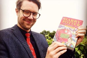 Jim Spencer with the Harry Potter first edition.