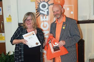 Outgoing Buxton Festival Fringe chair Keith Savage  presents the Chair Award to Netta Christie of Discover Buxton Tours.