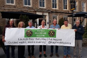 Hayfield Walkers Are Welcome committee, with their new publicity banner, taken outside the Royal Hotel in Hayfield; Graham Hirst; Julie Gough; Roy Lyon; Chris Hirst; John Harvey; David Gates; Peter Roberts