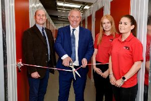 MP John Mann cuts the ribbon with by director Richard Stewart, sales assistant Lauren Williams and group general manager Sophie Trueman