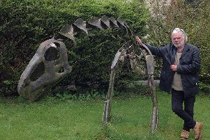 Buxton sculptor Andy Hill pictured with one of his dinosaur creations which have not been stolen