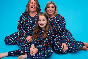 Abigail in the new PJs with her surgeon Benedetta and physio Carol.
