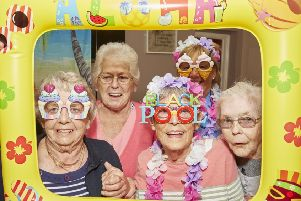 Picture postcard fun for these Richmond residents as they get in the holiday mood. They are (from left): Brenda Smith, Shirley Dolling and Cath Edwards, with staff member Sue Bills at the back. (PHOTO BY: Richard Tatham)
