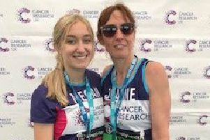 Joanne Nelson and daughter Megan with their medals after completing the Great North Run and raising �1,000 for Cancer Research UK.