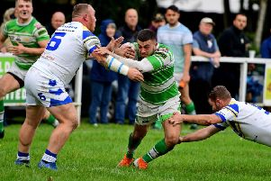 Dewsbury Celtic's looks for a way past Batley Boys defenders Adam Bingham and James Sheldon during last Saturday's National Conference League Division Three play-off semi-final. Pics: Paul Butterfield