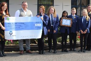 Cheryl and Gary Broughton receiving the cheque from students at The Manor Academy in Mansfield Woodhouse, who raised �960 for the couple's child-loss charity.