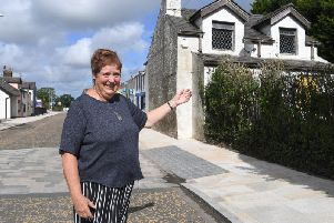 Council Chair Pat Hastings by the Toll Bar Cottage which will become a new community centre