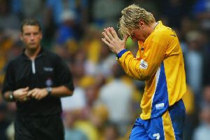 Liam Lawrence  holds his head after he missed a penalty during the Nationwide Division Three Play-Off Final between Huddersfield Town and Mansfield Town at The Millennium Stadium on May 31, 2004 in Cardiff, Wales.  (Photo by Stu Forster/Getty Images)