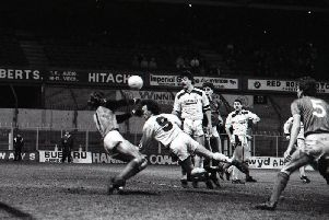 Preston striker John Thomas heads home the equaliser at Wrexham in the Feight Rover Trophy clash at the Racecourse Ground