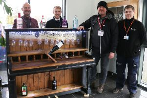Nicholas Hibbitt (second right) is presented with his piano bar by tutors Andy Whyley (left) and Reece Pridmore, and a student Daniel Stainwright.