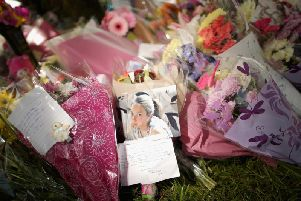 Flowers and tributes lay at the scene in Westfield Lane