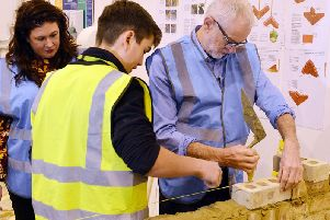 Jeremy Corbyn visits Vision West Nottinghamshire College's construction centre in Kirkby. Left is Labour candidate Natalie Fleet.