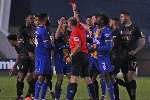 Referee Andy Haines shows the red card to Shrewsbury's Oliver Norburn