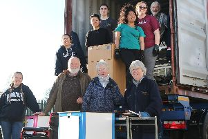 Volunteers at the Police Aid Convoys charity loading medical equipment into a container bound for Zambia