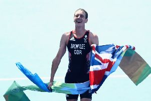 Alistair Brownlee crosses the line in Rio after defending his Olympic title.