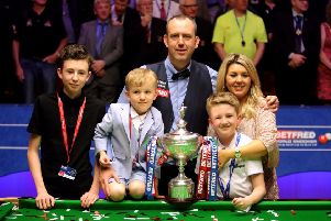 Mark Williams and his family with the trophy after winning the World Championship at the Crucible, Sheffield (Picture: Richard Sellers/PA Wire).
