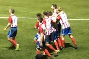 Gareth Curtis is mobbed by teammates after scoring Sherwood Colliery's second goal against Selston.