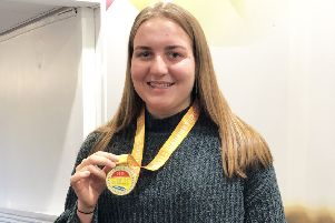 Lifesaver Ruth Moore with her gold medal.