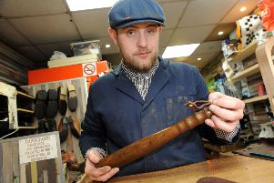 James Bevan from Mansfield Shoe Repairs with the 100 year old truncheon which he is repairing.