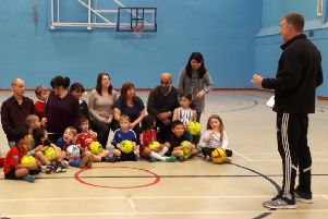 A family football session, run by the Community Sports Project.