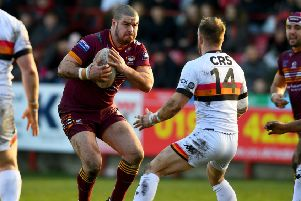 Batley prop James Brown looks to launch an attack under the watchful eye of Bradford hooker Matty Wildie during last Sunday's Yorkshire Cup Final at Mount Pleasant. Picture: James Hardisty
