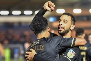 Mansfield Town's CJ Hamilton and Jacob Mellis celebrate their sides great comeback win after the game: Picture by Steve Flynn/AHPIX.com, Football: Skybet League Two  match Colchester United -V- Mansfield Town at JobServe Community Stadium, Colchester, Essex, England on copyright picture Howard Roe 07973 739229