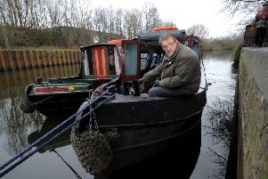 Float Your Boat's Alan Bolton with his dog Jasper. Picture by Simon Hulme