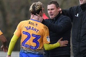 Mansfield's Jorge Grant celebrates his opening goal against Macclesfield with manager David Flitcroft.