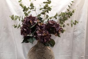 This vase and arrangement is on sale in the centre for 25 pounds